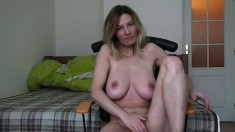 Blond MILF Vanessa gives close up shots while fingering her pussy