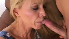 Gorgeous blonde milf with big tits wildly fucks a young guy's big cock